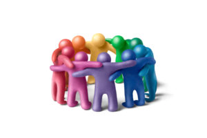 Multicolored plasticine human figures organized in a circle
